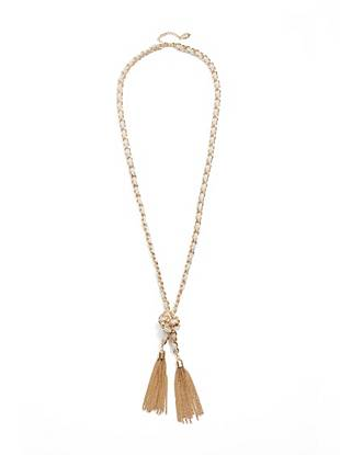 "Teaming vintage inspiration with an absolutely modern gilded finish, this tassel necklace makes a winning style statement. Wear it with flowing summer styles for chic shine. •	Gold-tone chain necklace with white accents and tassel trim •	15"" drop •	2"" extender •	Lobster clasp"