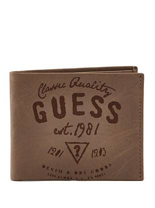 Distressed matte leather and a stamped vintage-inspired graphic make this wallet ideal for the guy with a rugged sense of style.