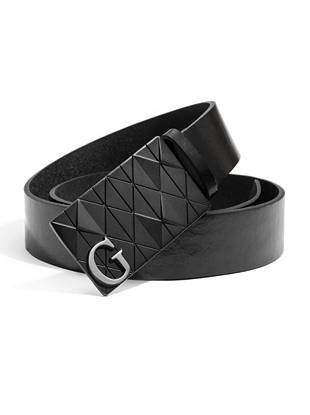 """Ultra-modern and detailed enough to make a statement, this leather logo belt transforms casual staples into anything-but-basic looks. Wear it with everything from suits to denim. •Black leather belt. Matte black hardware. •1 ¼"""" width •Plaque buckle with silver-tone G logo and diamond-texture detail •100% Leather"""