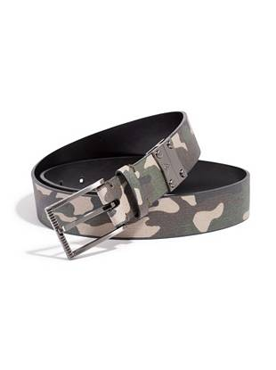 """Basic by day, trendsetting by night: this black/camouflage reversible belt does it all. Just flip it over to make a standout impression on any occasion. •Black/camouflage reversible belt. Logo-engraved buckle. Hematite-tone hardware. •1 ¼"""" width •Prong buckle •Faux leather"""