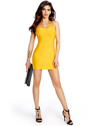 Artfully constructed and completely chic, this undeniably gorgeous bandage dress is all about the details. The body-hugging fit and streamlined silhouette add to its uptown edge.