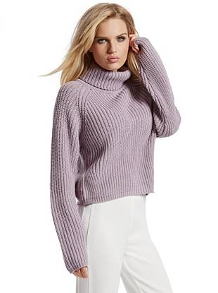 A must-own piece for cooler temperatures, this wool-blend sweater embodies the season's effortless mood. The turtleneck design keeps you warm and cozy while the cropped silhouette gives it an enviably modern look.
