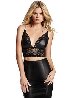 Showcase your seductive side in this irresistibly sexy lace crop top. Contrast faux leather brings tempting edge to the sheer, skin-revealing design.