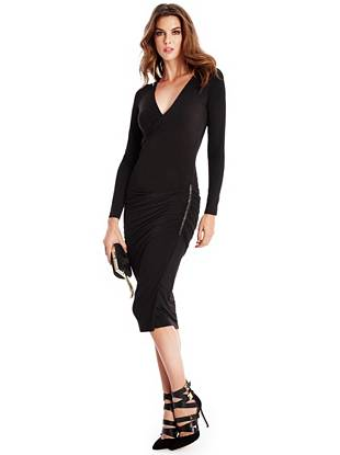 Look effortlessly sexy by slipping into this super-stretch knit dress. Shirred details create a draped effect that flatters every curve and  faux-leather contrast gives it a modern look.