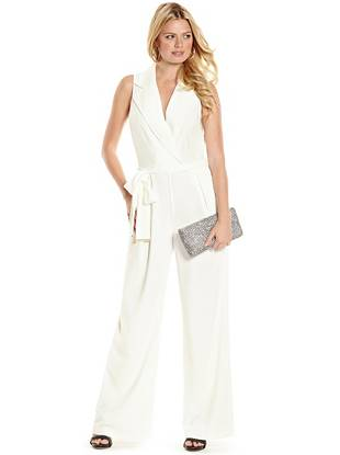 A sexy twist on the borrowed-from-the-boys trend, this tailored jumpsuit is your new work-to-weekend go-to. Featuring a flattering empire silhouette and tie-waist belt, it's the perfect polished piece.