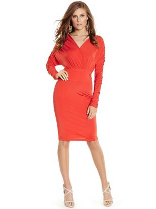 Sexy and modern, this stretch knit dress is the perfect addition to your LBD collection. Featuring a slinky draped design and low-cut neckline, it epitomizes flawless femininity.