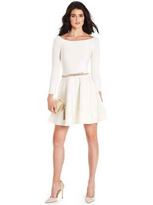 Playfully sexy with a hint of edge, this sweater dress flawlessly transitions from a.m. to p.m. The gold-tone chain cutout reveals a hint of skin while the fit-and-flare silhouette never fails to flatter.