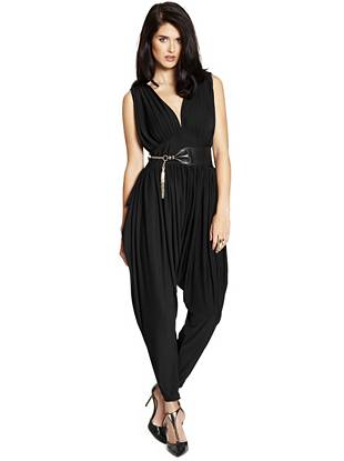 Effortlessly chic, this jumpsuit is ideal for the modern trendsetter. Jodhpur-style pants make a runway-worthy statement while the shirred details and fitted waist offer a sexy, flattering touch.