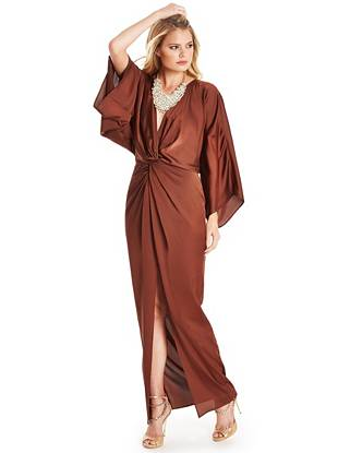 Soft, rich satin and an effortlessly luxurious silhouette blend to create this '70s-inspired gown. Finished with a sultry plunging neckline and sexy high slit, it symbolizes the return of one of fashion's most  glamorous decades.