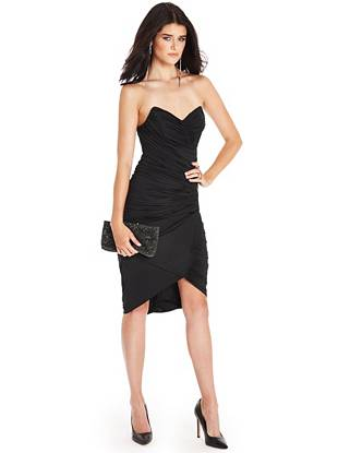 Exquisitely sexy, this body-hugging LBD is exactly what you need for an evening out. Allover shirred details create a flattering, draped silhouette while the faux leather contrast and pointed neckline add seductive edge.