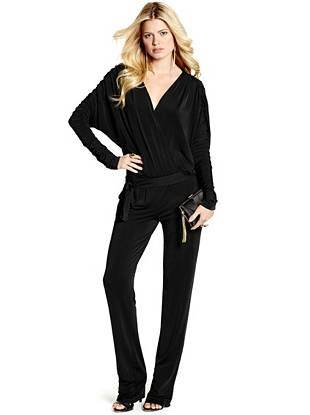 Sexy and modern, this stretch knit jumpsuit is the perfect alternative to an LBD for your next evening out. Featuring a slinky draped design and low-cut neckline, it epitomizes flawless femininity.