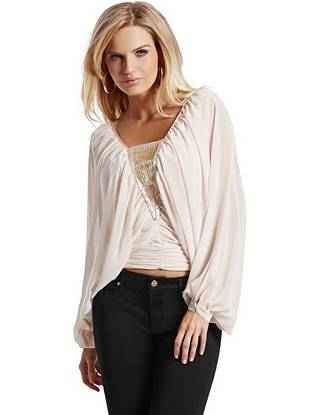 Bohemian glamour at its best, this top goes from office hours to after hours and beyond. The flowing design is adorned with a mixture of shimmering beads, creating a look that's both effortless and elegant.