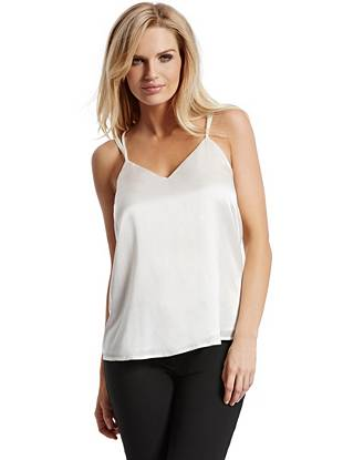 Always-chic silk and a lightweight design make this tank an essential for on and off the clock. Wear it solo on the weekends or under your favorite layering piece during the week—it works with anything in your wardrobe.