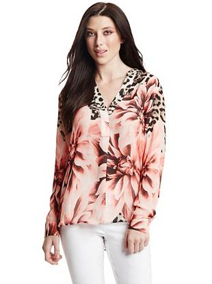 Rich, feminine florals and sexy, luxurious leopard bring trend-focused allure to this covetable printed blouse.