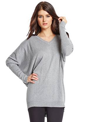 Soft wool-blend construction and a chic tunic design make this sweater your new cold-weather favorite. Plus, the full-length back zipper closure adds that essential element of edge.