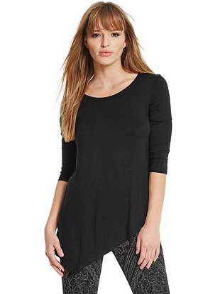 A modern asymmetrical hem brings trend-focused allure to this soft jersey tunic top.