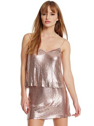 A '70s glam revival we're obsessing over… This shimmering chainmail top is what memorable nights are made of. The mesmerizing metallic sparkles and shines and the rose gold color complements virtually every skintone.
