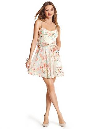 Spring is just around the corner, and this fit-and-flare dress is just what you need for the new season. Draped shirred details define your waist while the padded bust showcases your sexy femininity.