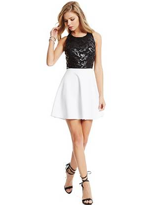 A luxurious mix of faux leather and lace details this sexy fit-and-flare dress. Finished with a scuba-knit skirt and color-blocked design, it keeps you chic and on trend all season long.