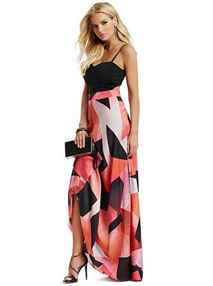 A vibrant fusion of sunset shades and graphic shapes brings eye-catching allure to this evening essential. Constructed with an ethereally flowing skirt and exquisitely placed back cutout, it's sure to turn heads at your next event.