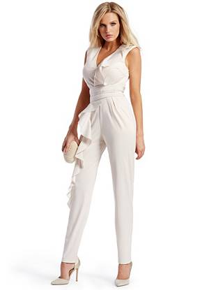 Master the jumpsuit trend with polish and poise in this effortlessly sophisticated piece. Detailed with feminine ruffles and finished with a modern tapered leg, it's perfect for those desk-to-dinner days.