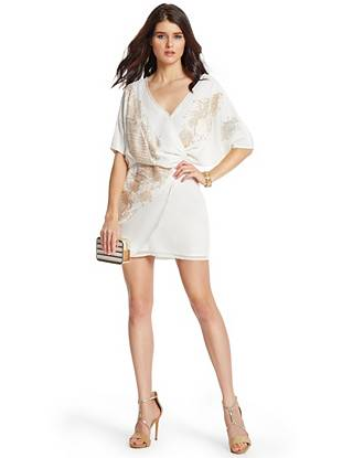 A sultry wrap design and shimmering beaded adornments lend exquisite allure to this LWD. Layer it under a luxe cover-up for the winter months then wear it solo through the warmer seasons—it works for every occasion.