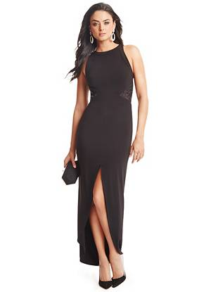 A luxurious mix of faux leather and lace details this exquisite floor-length dress. Plus, the high neckline plays off the seductive front slit for a look that's elegant with that essential touch of sexy.