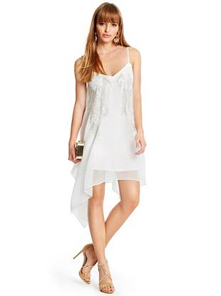 A sultry draped design and shimmering beaded adornments lend exquisite allure to this LWD. Layer it under a luxe cover-up for the winter months then wear it solo through the warmer seasons—it works for every occasion.