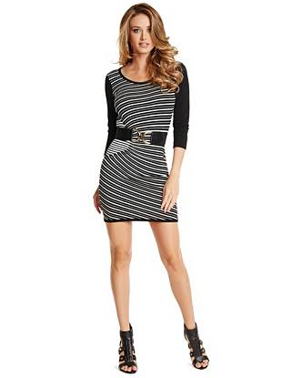 Soft, slimming and completely chic—there's no wrong place to wear this sweater dress. The flattering mix of stripes play off solid sleeves for a modern look that's right in line with the season's color-blocking trend.