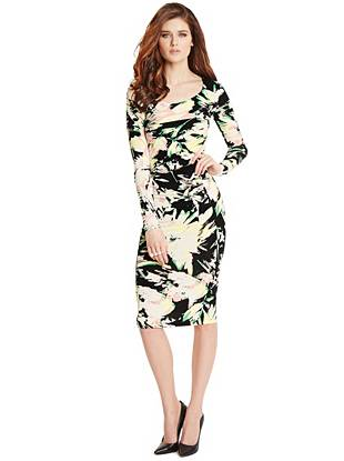 Round out your spring wardrobe with this ultra-flattering dress. The stretch ponte construction hugs your curves in all the right ways while the abstract floral print creates a slimming effect that won't go unnoticed.