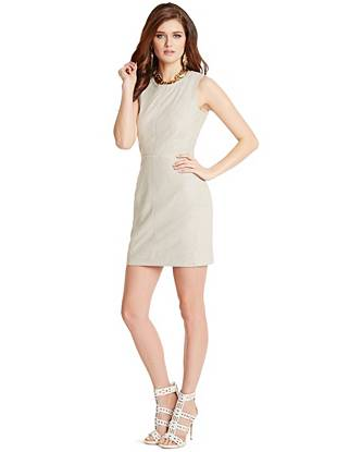A timeless silhouette and luxe suede construction make this dress the ultimate buy-now, wear-forever essential. Layer it for a corporate lunch or add high-shine accents after dark—either way, it's sure to be the most-talked-about piece in the room.