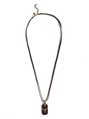A rugged cow skull, brass tone and leather detail update this wear-all-day dog tag necklace.