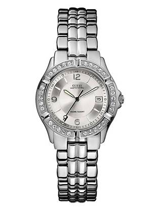 With a timeless design and beautiful Swarovski crystal accents, this silver-tone watch makes a confident addition to everyday looks.      • Japanese movement • Stainless steel case • Stainless steel bracelet • Swarovski crystal accents • Water resistant up to: 100 m/330 ft  • 10 Year Limited Warranty