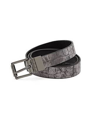 Fashion meets function with this reversible faux-leather belt. Wear it on the crocodile-embossed side for an exotic pop or switch it over to the solid side for a more subtle finish.