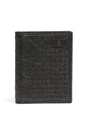 Cleverly designed with a gusseted card slot, this textured genuine leather card case offers extra space without the added bulk. Plus, modern laser-cut details bring contemporary fashion to the functional style.