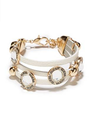 Soft white leather and gold-tone rhinestones team up to create the ultimate 24/7 accessory. Wear it solo or stack it on with other arm candy for the perfect blend of glamour and edge.