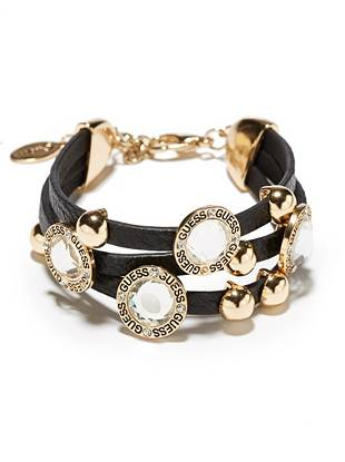 Soft black leather and gold-tone rhinestones team up to create the ultimate 24/7 accessory. Wear it solo or stack it on with other arm candy for the perfect blend of glamour and edge.