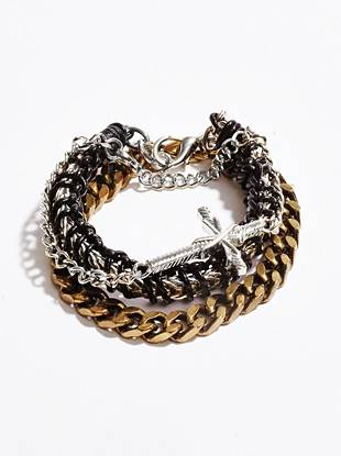 A mix of silver and gold-tone chains gives this bracelet set a distinctive look while a cross charm brings a classic touch.