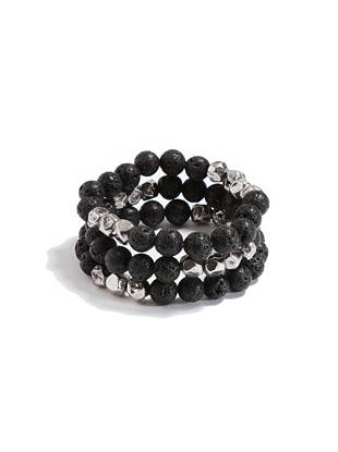 """Go for an accent that works with every look, in every season, with this simple beaded bracelet set. Add it with everything from hoodies to blazers for a vibe that's just right. •Set of three bracelets •Black beads with silver-tone textured accents •Stretch fit •Approximately 3"""" diameter"""