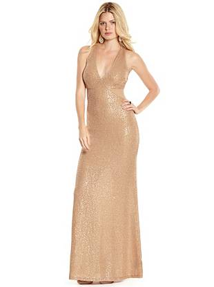 Make a stunning entrance at your next event in this gold-tone sequin gown. Transparent mesh and back cutouts reveal just the right amount of skin while the slinky silhouette delivers effortless elegance.