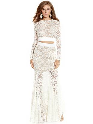 Channel bohemian chic style with this exquisite two-piece dress. The transparent lace crop top layers over an ethereally flowing maxi skirt to create the illusion of one statement-making gown.