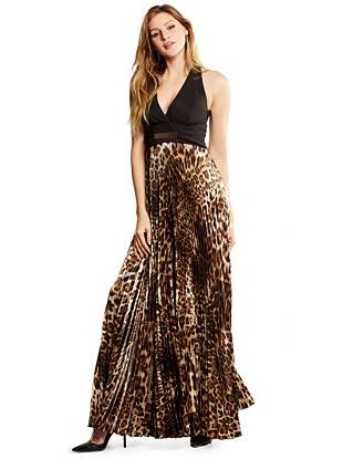 Make a stunning entrance at your next event in this exotic and tempting gown. Featuring a sexy open back, glamorous gilded detail and free-flowing pleated skirt, it puts all the attention right where it should be—on you.