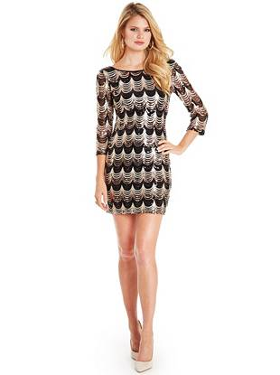 Glamorously sexy, this minidress is the ultimate conversation piece. The retro-inspired sequin design makes a luxurious statement that instantly puts you in the spotlight.