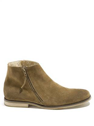 Capturing the vintage spirit that's been ruling the fashion world is as simple as zipping up these suede booties. Lightly scuffed for that worn-in vibe, they add trend-focused direction to any look.      • Suede booties. Zipper closure at outer ankle. • Lightly scuffed details at heel and toe • Materials: Suede, Rubber