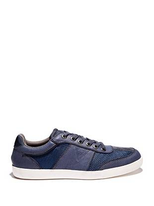 A modernized take on the classic sneaker, these low-top shoes are your go-to for casual weekends. A mixed-material design and contrasting white sole make them perfect for polishing off any summer look.
