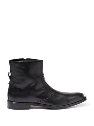 Sleek and versatile, these zip-up boots work for casual and dressier looks. Try them with cuffed jeans and a sweater or a button down and a blazer—anything goes.       • Rounded-toe boots • Side zip closure. Rubber sole. • Black material: Leather • Brown material: Suede