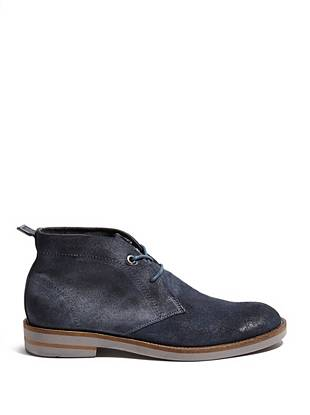 Online Exclusive Smooth genuine suede and a modern chukka design make these shoes a versatile pair to own.