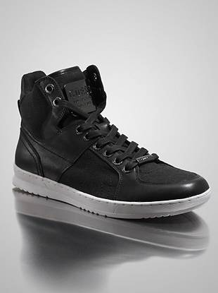A leather and canvas combo make high-top sneakers that take your graphic-tee-and-jeans look to another level.     • Mixed-media high-top sneaker. Lace-up. • Hematite-tone hardware. Logo plaque at the tongue and laces. Rubber sole. • Material: Leather, Canvas