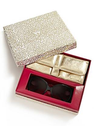 Give her the gift she'll wear everywhere with this ultra-glamorous eyewear box set. Gleaming crystal details and a gold faux-leather case make this a need-now pair for every fashion lover.