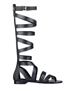 The gladiator sandal is summer's most-wanted trend, and this sexy pair is just what your weekend looks need. Snake-embossed details and a knee-high design deliver modern glamour to the warrior-inspired style.